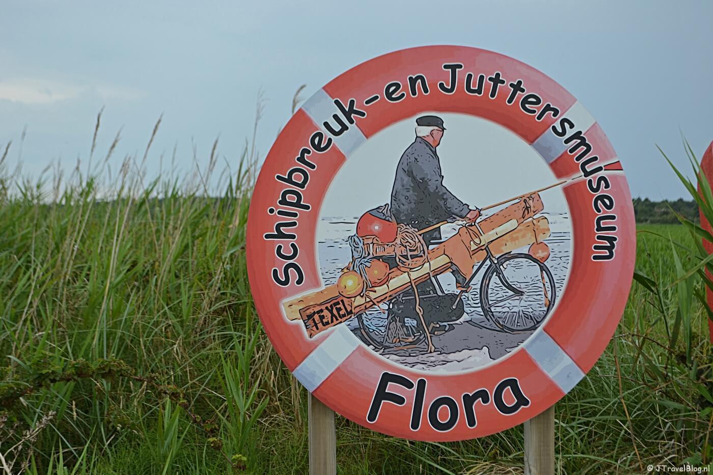 Logo van het Schipbreuk- en Juttersmuseum Flora in De Koog